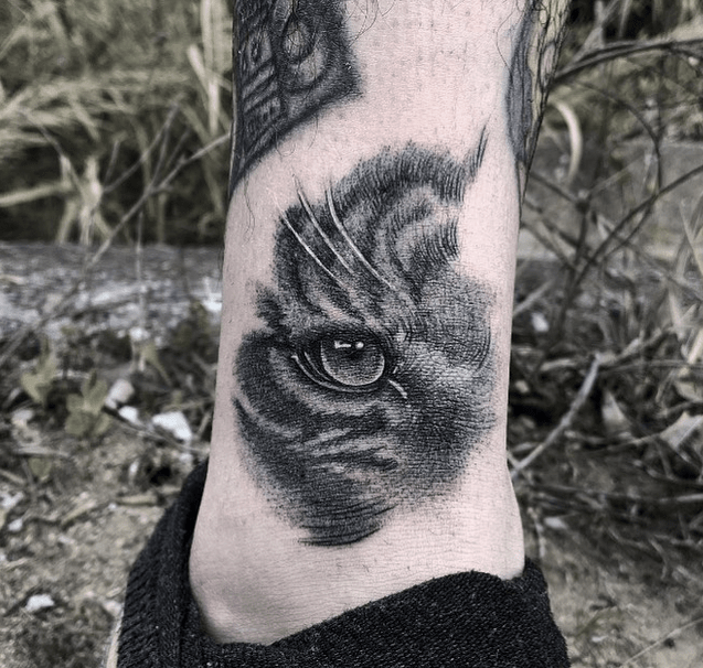 Tiger eye tattoo on the ankle by @giambaaa
