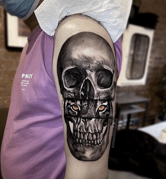 Tiger eyes in the skull tattoo by @chantellethongtattoos