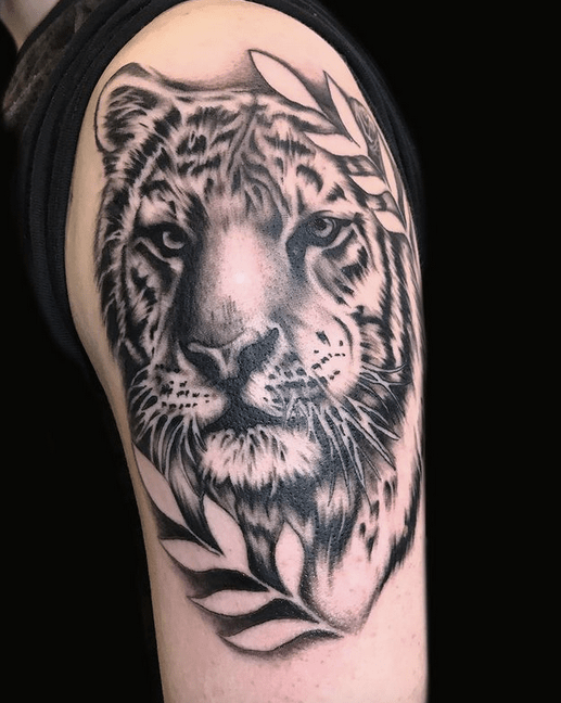 Tiger head with leaves tattoo by @loveink_official