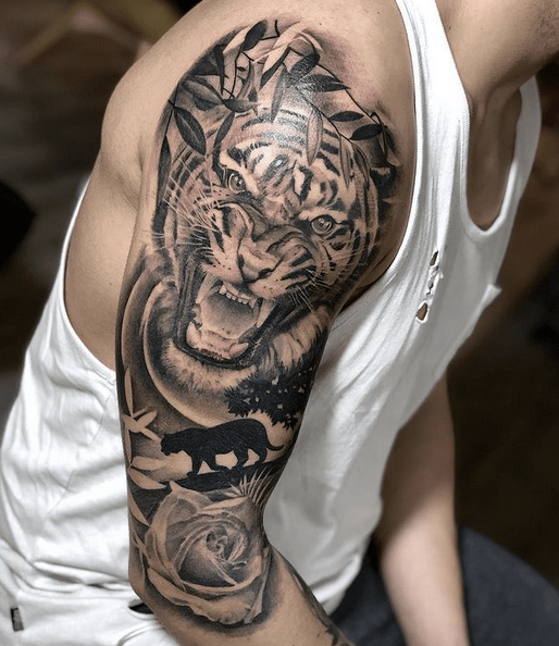 Tiger sleeve tattoo with nature scene by @emanuelemasin