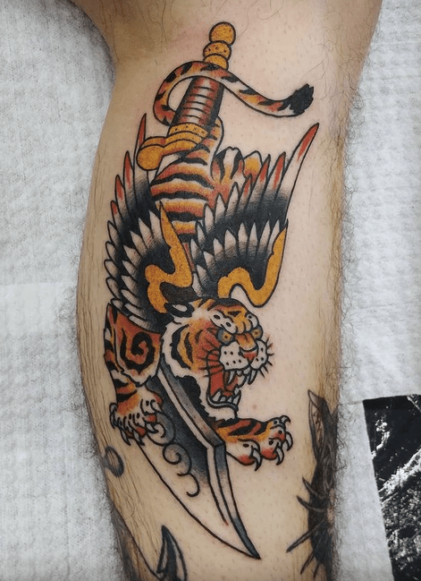 Tiger with wings and sword traditional tattoo by @delange_tattooing