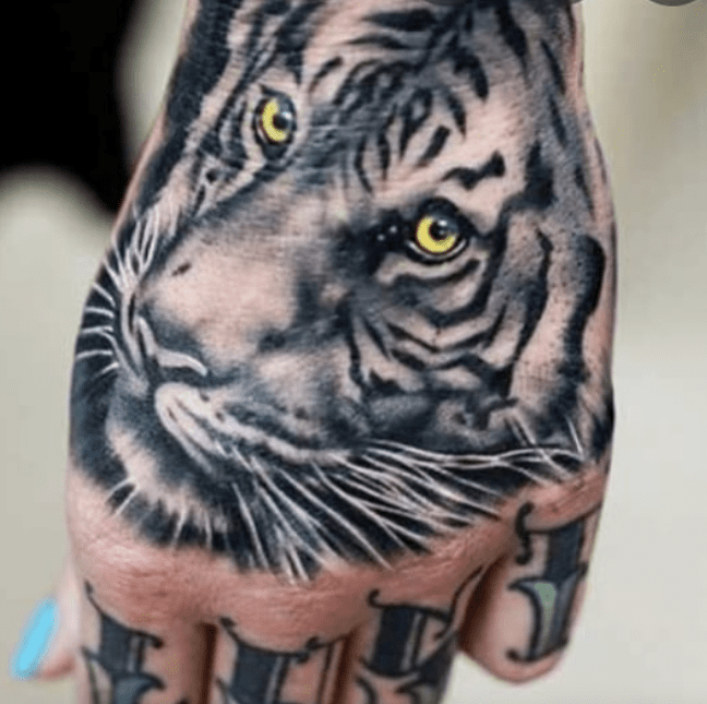 White tiger hand tattoo by @laflacajay