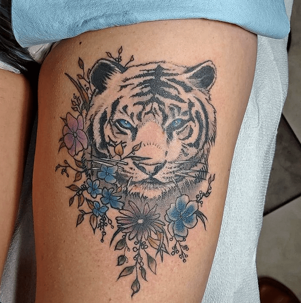 White tiger head with flowers tattoo by @ramseyryetattoos