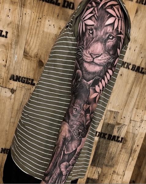 Wildlife tattoo sleeve by @painfreetattoos