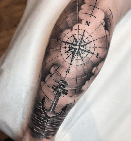 Anchor and compass on sea tattoo by @vrodtattoos
