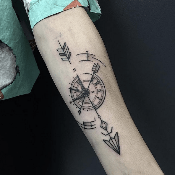 Arrow and compass tattoo by @ostatattoo