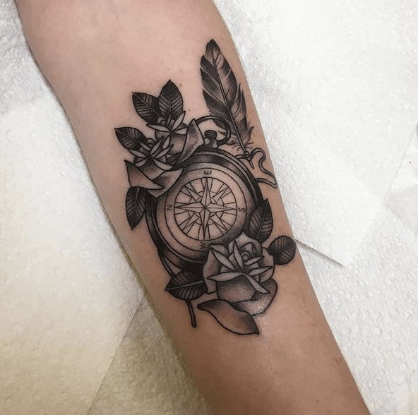 Black and grey traditional compass tattoo by @anikalukinstattoo