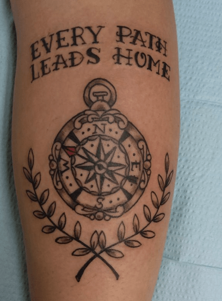 Black traditional compass tattoo by @chopperpetetattoo
