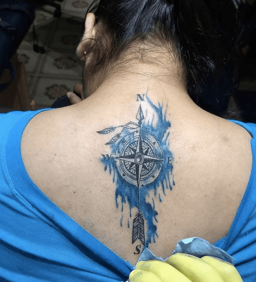 Blue watercolor compass tattoo with an arrow by @jahviroom