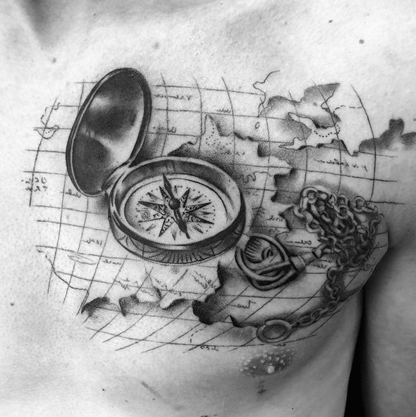 Compass on a map chest tattoo by @treyayim_tattoo