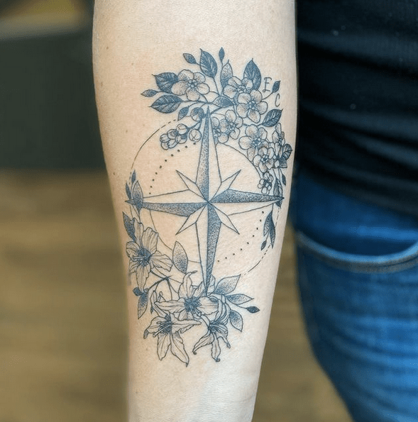 Compass rose with flowers tattoo by @shaina.chavda