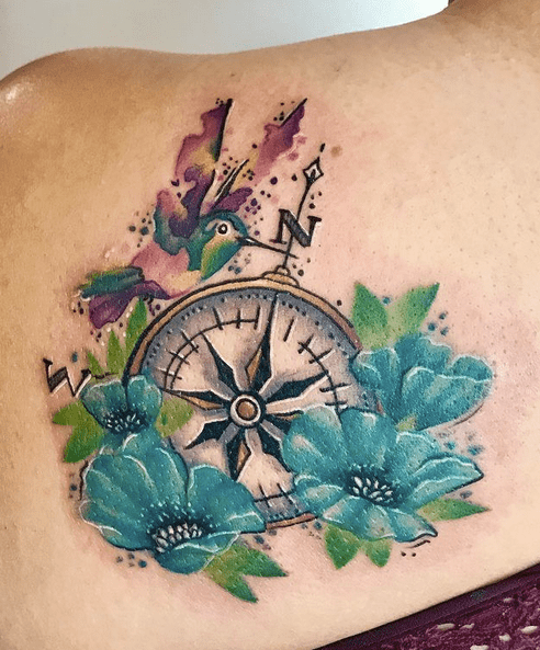 Compass tattoo with watercolor flowers by @christinamm31