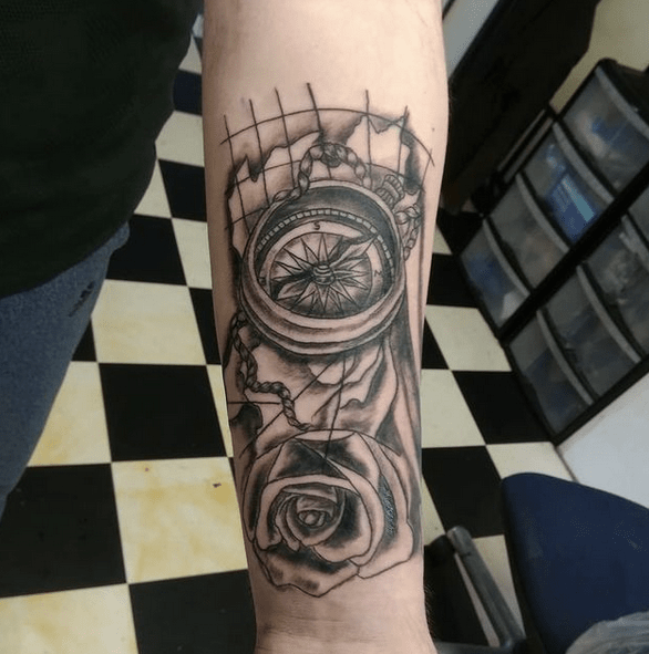 Compass with a rose tattoo by @nannyflostattoo
