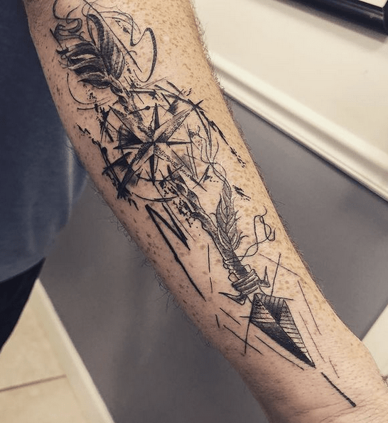 Dark abstract arrow and compass tattoo by @ooohchild83