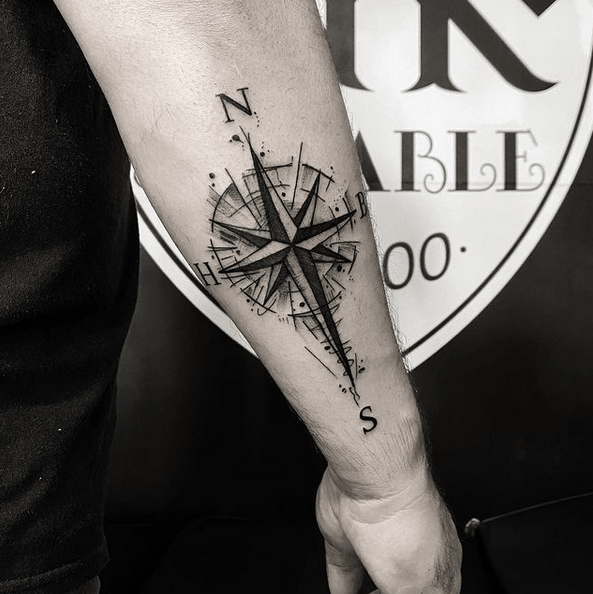 Dark compass rose tattoo on the forearm by @inksaciable