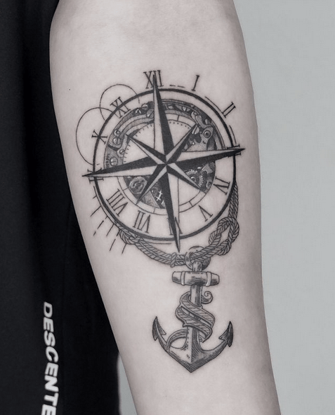 Elegant compass rose and anchor tattoo by @tattooist_andy