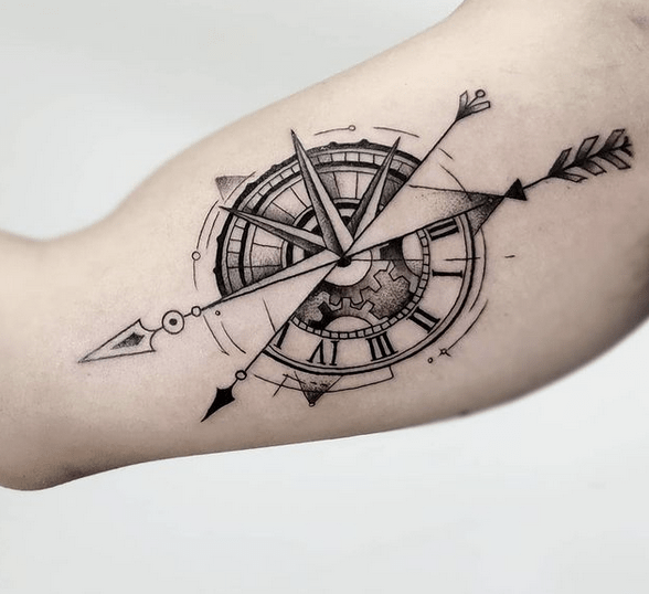 Geometric arrow through compass tattoo by @isarin_kwan