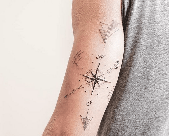 Geometric compass tattoo on forearm by @mademoiselle_germaine_tattoo