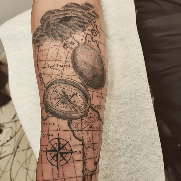 Inner forearm compass tattoo by @studio_thir13en