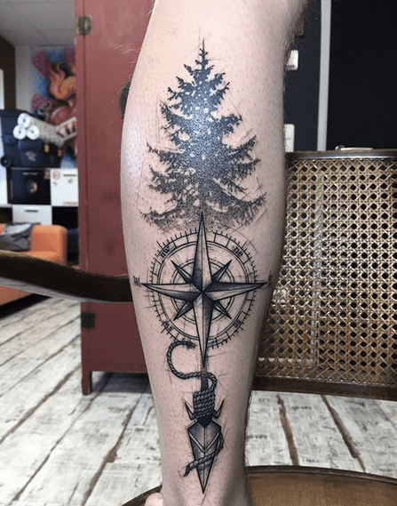 Native arrow and compass outdoors tattoo by @crystal_ink_