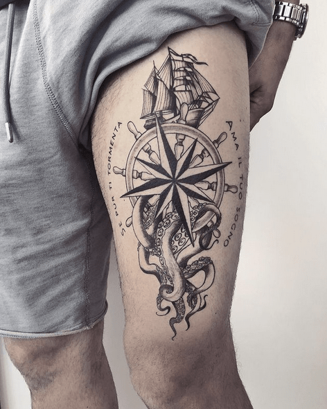 Nautical tattoo with compass rose sea and steering wheel by @magenta_tattoo_lab