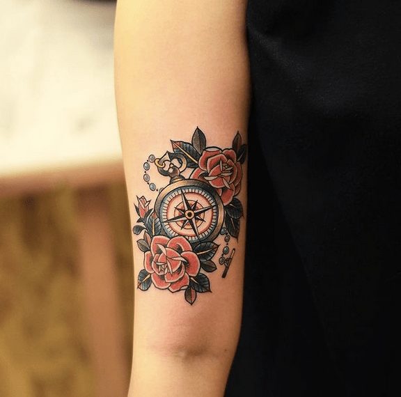 Old school compass and roses tattoo by @tattoograin