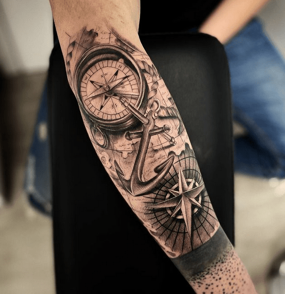 Realistic compass anchor and map tattoo by @manuelrossi_tattoo