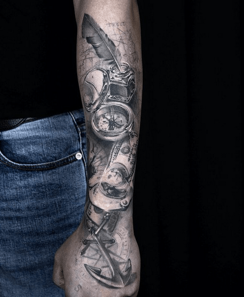Realistic forearm anchor and compass tattoo by @graydrilltattoo
