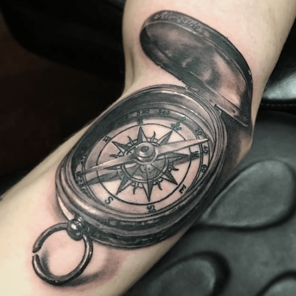 Realistic nautical compass tattoo by @loveandhatetattoo