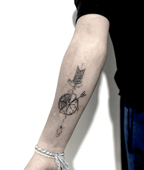 Simple forearm arrow and compass tattoo by @dan_artat