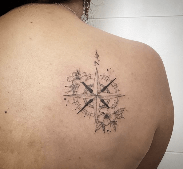 Small fineline compass rose with flowers tattoo by @elfa.ink