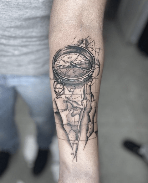 Small realistic compass and map tattoo by @sasha_tattoos