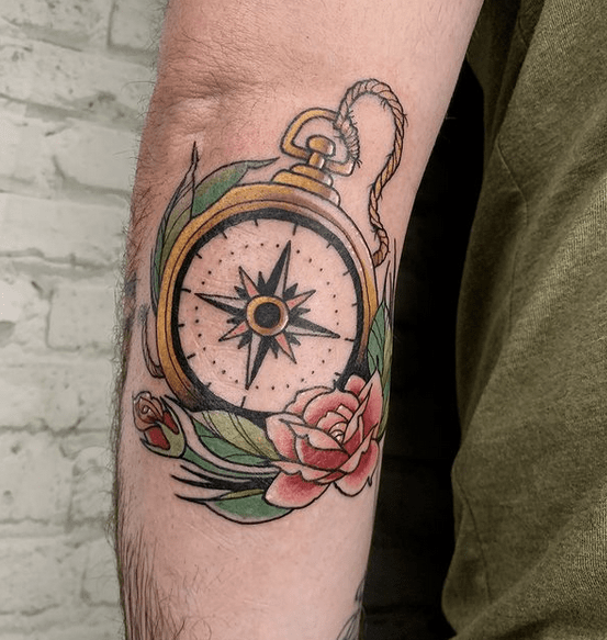 Traditional golden nautical compass tattoo by @pinupparlortattoo