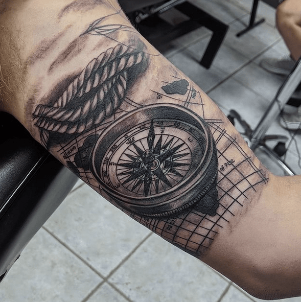 Upper arm nautical compass rope tattoo by @smokingunsink