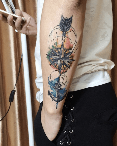 Watercolor arrow and compass tattoo by @mia.tats
