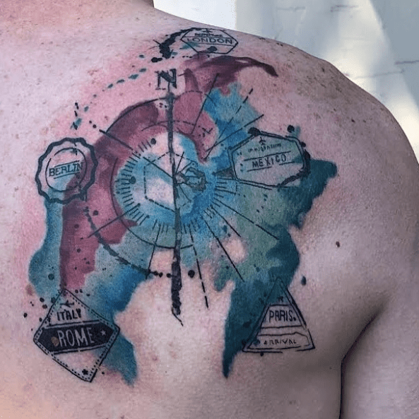 Watercolor compass with travel stamps tattoo by @tyler_bromudez