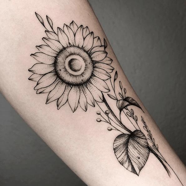 Big forearm fineline sunflower tattoo by @gilajos.tattoo