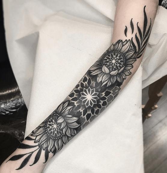 Big forearm sunflowers with mandala by @paddy.dundon.tattoo