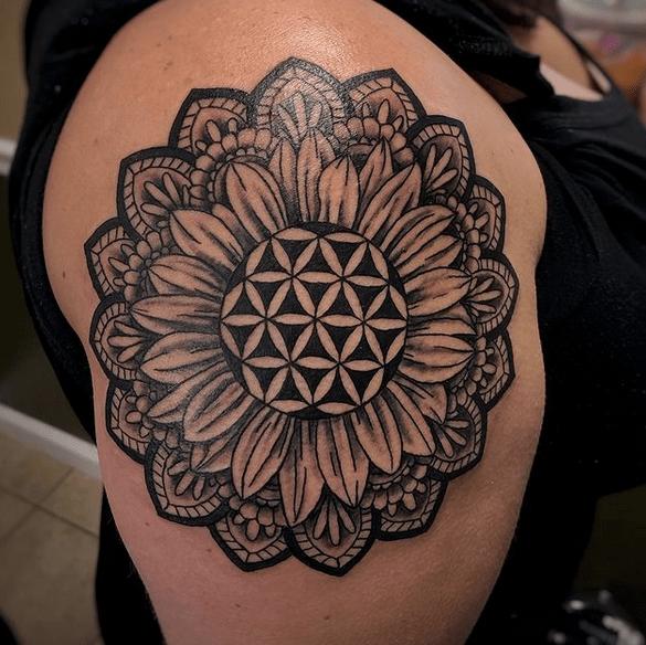 Big sunflower in a mandala thigh tattoo by @cudatat