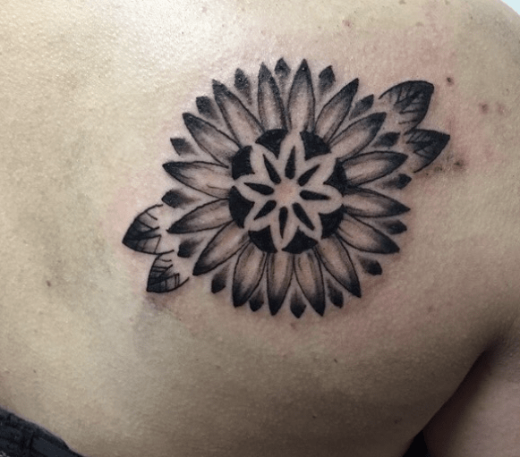 Black mandala sunflower tattoo by @laura_bowtattoo