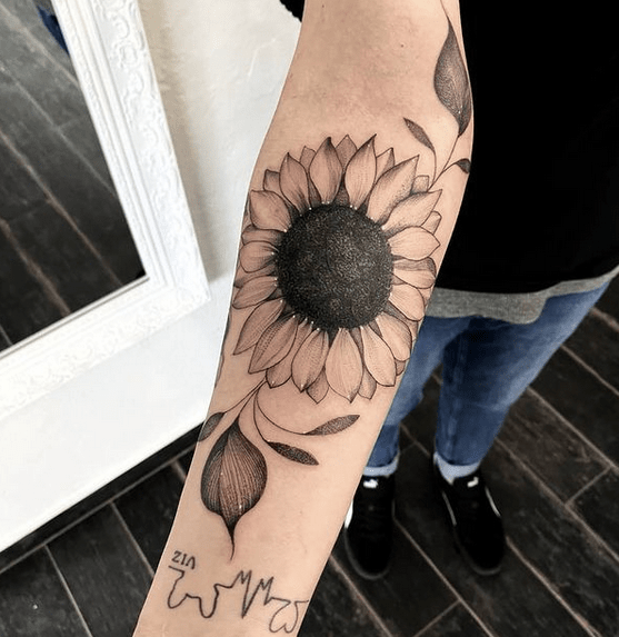 Black seed sunflower tattoo by @theblackpencil_