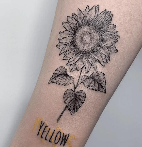 Black simple sunflower tattoo by @giada_tempo