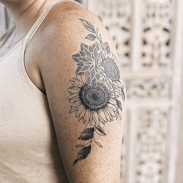 Black sunflower mandala tattoo by @jmsntattoos