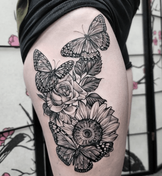 Butterflies roses and sunflowers thigh tattoo by @tattoosbymarilyn