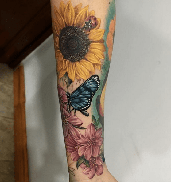 Butterfly cherryblossom sunflower tattoo sleeve by @rejanetattoo