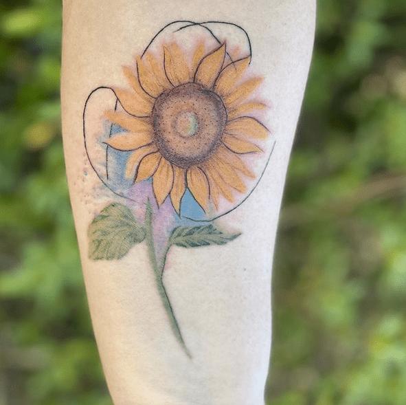 Cartoony small watercolor sunflower tattoo by @moni_tattoo4u