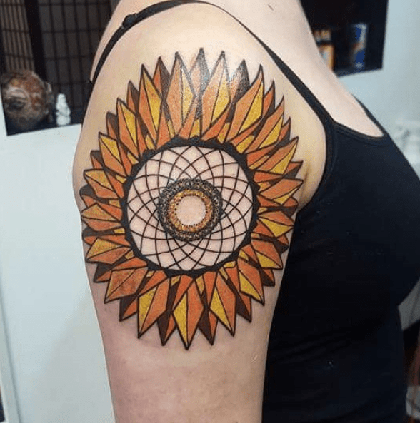 Colorful geometric sunflower tattoo on the shoulder by @sam_hyndman