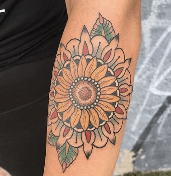 Colorful sunflower in a mandala tattoo by @wealthystreettattoo