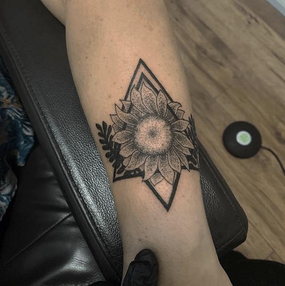 Dotwork sunflower head tattoo by @briefraserdesigns