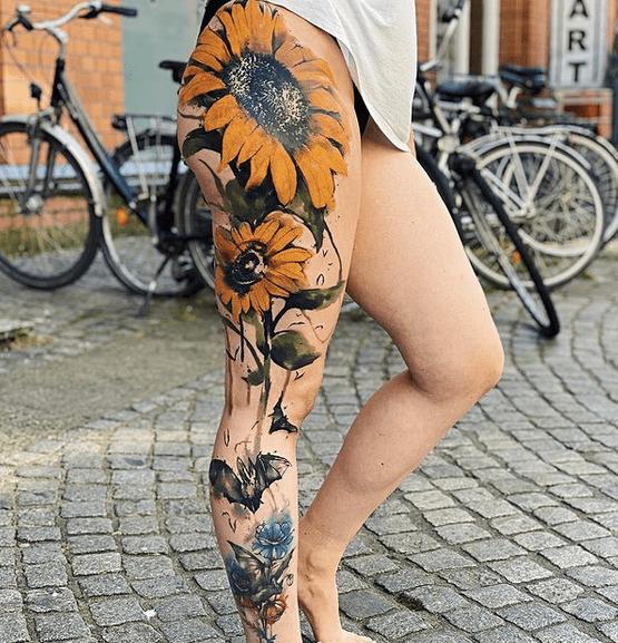 Full leg watercolor sunflower tattoo design by @atelier_hafenpoesie